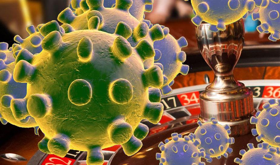 coronavirus en roulettetafel in het casino op de achtergrond